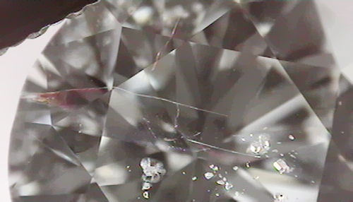 Fracture filled diamond. The filled fracture can be identified by its colorful flash effect.