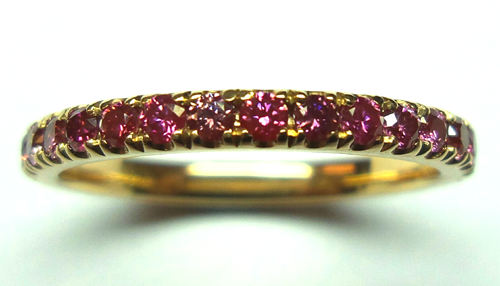 A ring set with HPHT-treated red diamonds